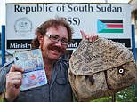 Finish line: Graham Hughes yesterday trudged into Juba, the capital of South Sudan, to end the epic four-year journey that began in his hometown of Liverpool on New Year's Day 2009