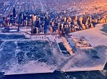 Frozen over: Pilot Hank Cain takes an overhead picture of Chicago and Lake Michigan. Temperatures in the Chicago area dropped as low as 14F (-25.5C)