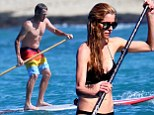 The disgraced cyclist, 42, showed off a bit of a paunch as he paddled shirtless in the Hawaiian waters with girlfriend Anna Hansen, 32.