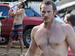 He's still an Absolut hunk: Sex and the City star Jason Lewis flaunts his rippling muscles on the beach in Hawaii