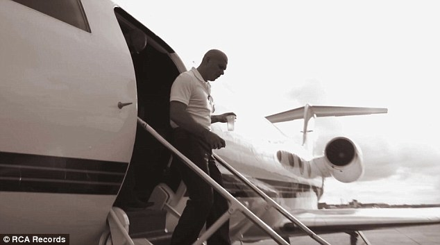 Flying high: Pitbull shows how well he is doing - flying in private jets, staying and recording in the world's top hotels and performing to thousands of people