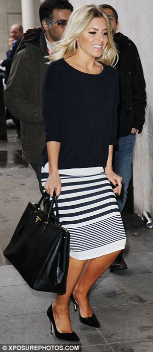 How very chic of you: Mollie, 25, teamed her striped pencil skirt with a jumper and black heels