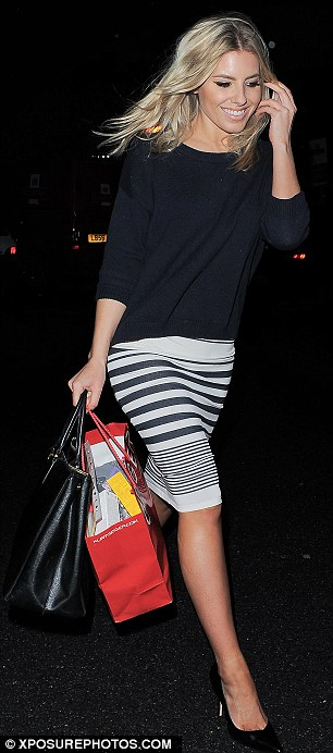 Best foot forwards: Mollie King looked great in a stripey skirt and black jumper