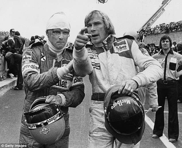 Rivals: Niki Lauda (left) and James Hunt argue about a crash between the two at Zolder race track, Belgium