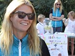 Gwyneth Paltrow helps Apple and Moses sell homemade lemonade and cookies... which of course are '100% organic'