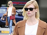 Out and about: January Jones was seen out in Los Feliz on Tuesday, carrying her boots instead of wearing them