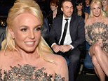 Lucky he scrubs up well! Britney Spears and boyfriend Average Dave watch on as her ex Justin Timberlake cleans up at the People's Choice Awards