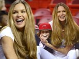 Turning up the Miami Heat: Elle MacPherson looks white hot as she sits courtside with son for basketball match