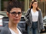 Make-up free Marisa Tomei wears drab cardigan and grungy boyfriend jeans for lunch on Melrose