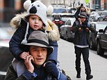 His cuddly koala bear! Orlando Bloom's son Flynn wears sweet animal beanie as he goes for a ride on his father's shoulders