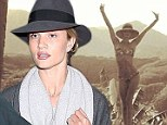 Rosie Huntington-Whiteley shares snap of idyllic scene while posing in strapless bikini for last time... before flying home with Jason Statham