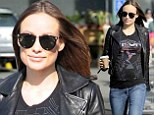 Proud star: Pregnant Olivia Wilde covered her baby bump with a Tron T-shirt as she shopped at Whole Food Market in West Hollywood, California on Wednesday
