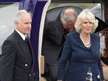 Safe: Camilla, Duchess of Cornwall, and the Prince of Wales after another flight