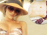 Her most daring selfie yet! Rosie Huntington-Whiteley goes topless as she models just a tiny pair of bikini bottoms on Hawaiian holiday