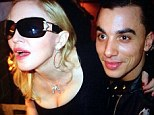 First photo together! Madonna, 55, looks blissful as she puts arm around 'new toy boy' - backup dancer Timor Steffens, 26 - on New Year's Eve