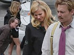 Gwyneth Paltrow struggles with her slim-fitting LBD on Mortdecai set before costar Johnny Depp steals her seat