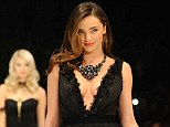 Turkish delight! Miranda Kerr distracts from her $3 million necklace as she takes the plunge in several revealing gowns during catwalk show in Turkey