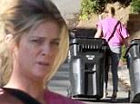 A rubbish job! A barefaced Rachel Hunter looks casual as she hauls her trash bins