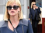 Pulling double duty! Reese Witherspoon picks up her dry cleaning in chic blue jacket and heels after business power lunch