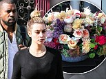 Good influence: Kim Kardashian 'becoming generous thanks to Kanye West as she picks up habit of sending fancy flowers'