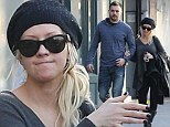 Behind the make-up: Christina Aguilera gives a rare glimpse of her natural beauty as she goes bare-faced for day out with her boyfriend