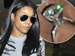 Simply sparkling! Gabrielle Union shows off diamond engagement ring as she makes low key arrival into LAX, while fianc� Dwyane Wade stays in NYC