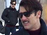 On the set: Clive Owen sported his pencil moustache on Wednesday while filming in New York City