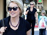 Like mother, like son! Sharon Stone and son Roan sport similar blonde crops as they shop for toys