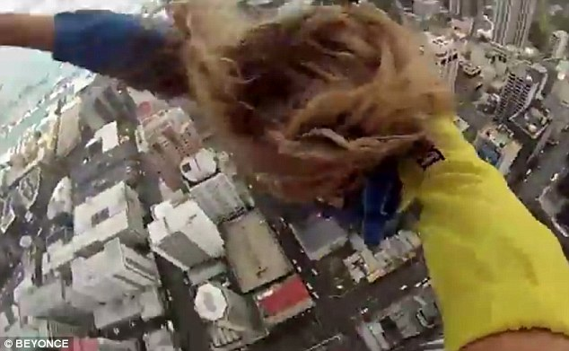 What a view! The superstar carries on filming as she gets a bird's eye glimpse of the city