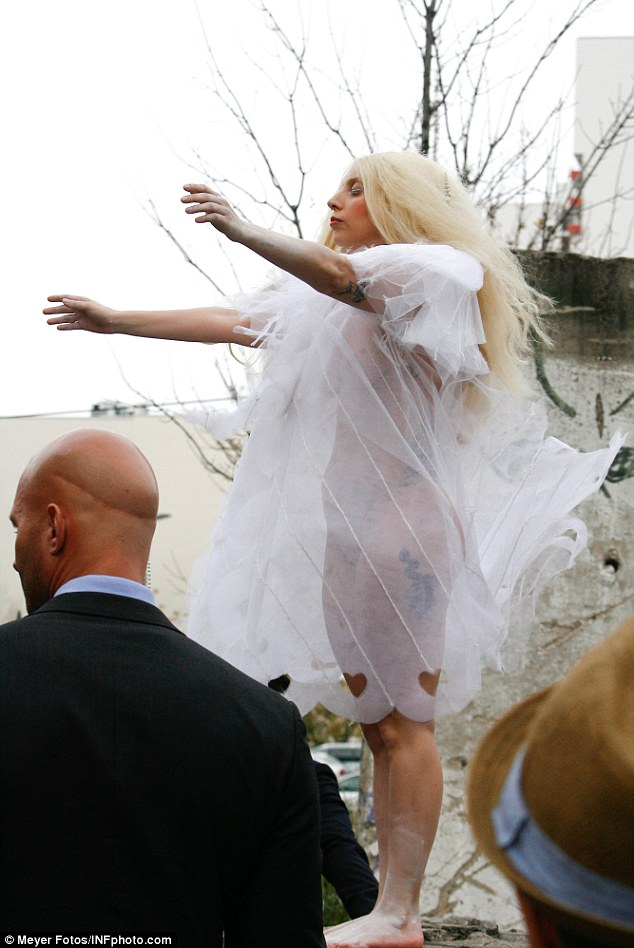Not so angelic: Lady Gaga shows off a bit too much cleavage as she leaves the Ritz Carlton hotel in Berlin on Thursday.
