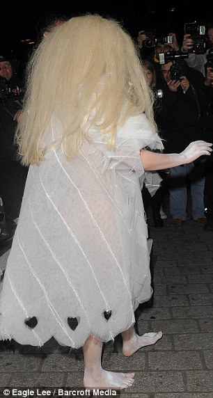 Baring all: Gaga's dress became rather see-through underneath the flash of the cameras