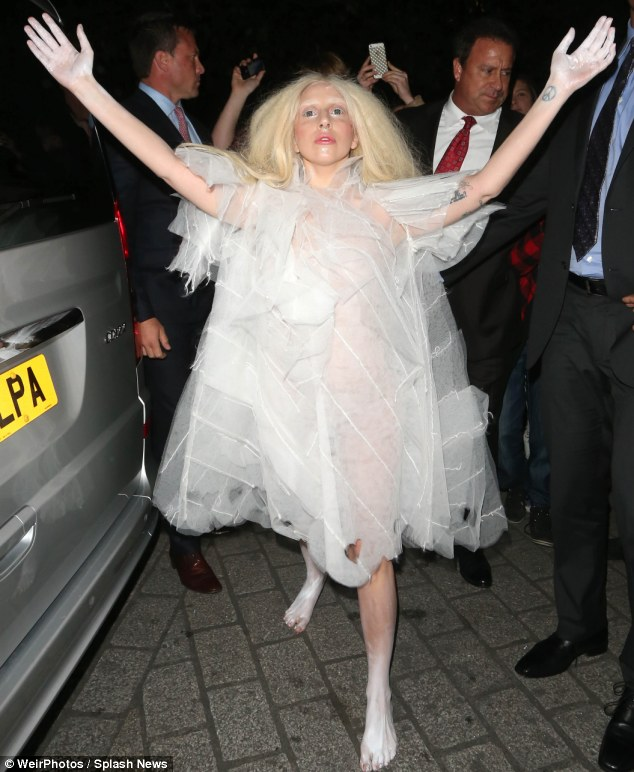 Mad Messiah: Lady Gaga arrived at her London Hotel wearing a spooky see-through dress, white painted bare feet and creepy lenses