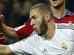 Heading ahead: Karim Benzema celebrates after giving Real Madrid the lead in the first half