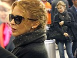 Kylie Minogue dashes through airport in chic skinny jeans and boyfriend-style cardigan ahead of The Voice launch