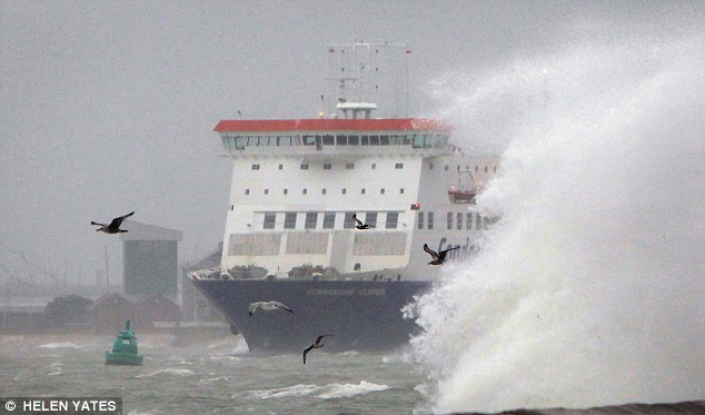 A ferry crosses the Solent near Southsea sea front in Hampshire. Forecasters predict the stormy weather and heavy rains could last for a month