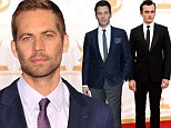Leading roles: The late Paul Walker, shown in May in London, was slated for two leading roles in upcoming films that have been offered to other actors following his November 30 death