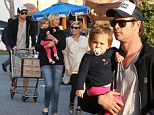 Thor's still got his strength! Chris Hemsworth cradles daughter India while buying health food with pregnant wife Elsa as he continues 500-calorie-a-day diet