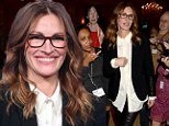 She means business! Julia Roberts looks smart and chic in skintight leather trousers to discuss her new TV movie at panel event