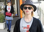 Making a statement! January Jones steps out in a fedora and an awareness raising T-shirt while shopping