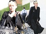 Now for my demure look: Miley Cyrus is elegant and grown up in head-to-toe black and Chanel accessories