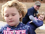 On the mend: Honey Boo Boo shows off cheerleading moves with a little help from dad Sugar Bear following check-up for injuries suffered in car crash