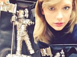 She can't have nice things! Taylor Swift nearly breaks MTV Video Music Award moments after receiving trophy in the mail