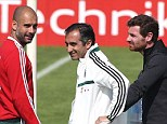 Meeting: Andre Villas-Boas (right) chats with Bayern boss Pep Guardiola (left) at a training camp in Doha