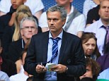 Jotting it down: The sight of Jose Mourinho on the touchline taking notes is a familiar one