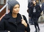 Super-cool: Pregnant Thandie Newton looked effortlessly cool as she strolled in London