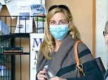 Camille Grammer takes extra precautions by wearing surgical mask for shopping trip after declaring she is 'cancer free'