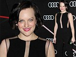 Elisabeth Moss stands out in a black jumpsuit with sheer plunging neckline at party to celebrate Golden Globes weekend