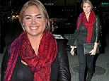 Well, that's different! Kate Upton covers up for a change but still manages to flash a sneaky peak of her bra at the basketball