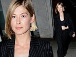 Peek-a-boo! Rosamund Pike bared her taut tummy as she stepped out in Beverly Hills, California on Friday