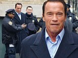 No Kindergarten Cops! Sharp looking Arnold Schwarzenegger gets mobbed by New York City police officers